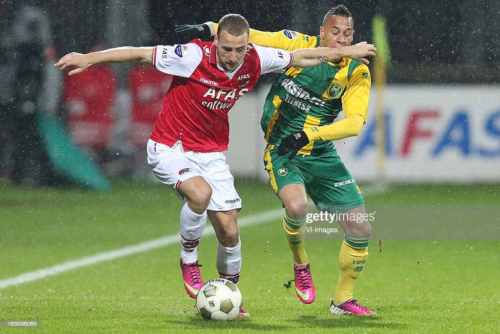 Roy Beerens of AZ , Tjaronn Chery of ADO Den Haag during the Dutch Eredivisie match between AZ Alkmaar and ADO Den Haag at the AFAS Stadium on march 09, 2013 in Alkmaar, The Netherlands