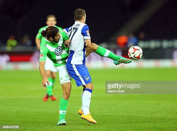 Roy Beerens of Berlin battles for the ball with Ricardo Rodruguez of Wolfsburg during the Bundesliga match between Hertha BSC and VfL Wolfsburg at...