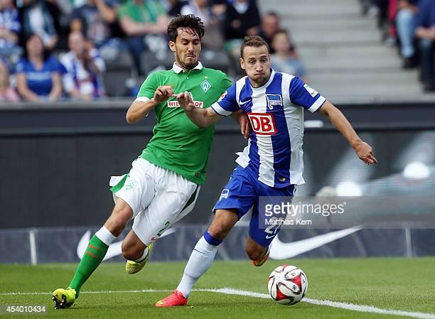 Roy Beerens of Berlin battles for the ball with Santiago Garcia of Bremen during the Bundesliga match between Hertha BSC and SV Werder Bremen at...