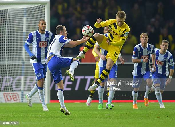Roy Beerens of Hertha BSC and Jakub Blasczykowski of Borussia Dortmund duel during the game between Hertha BSC and Borussia Dortmund on december 13...