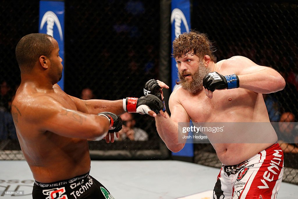 Roy 'Big Country' Nelson looks to punch Daniel Cormier in their UFC heavyweight bout at the Toyota Center on October 19 2013 in Houston Texas Daniel...