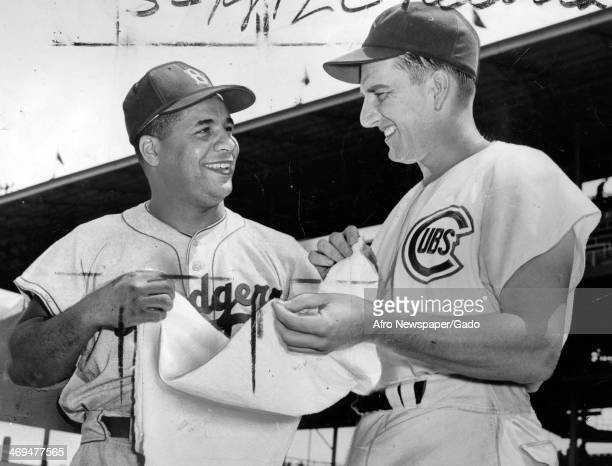 Roy Campanella catcher for the Brooklyn Dodgers talks with a baseball player for the Chicago Cubs 1940