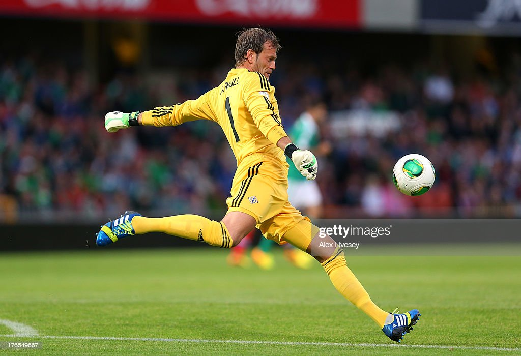 <a gi-track='captionPersonalityLinkClicked' href=/galleries/search?phrase=Roy+Carroll&family=editorial&specificpeople=206286 ng-click='$event.stopPropagation()'>Roy Carroll</a> of Northern Ireland clears the ball during the FIFA 2014 World Cup Group F Qualifier match between Northern Ireland and Russia at Windsor Park on August 14, 2013 in Belfast, Northern Ireland.