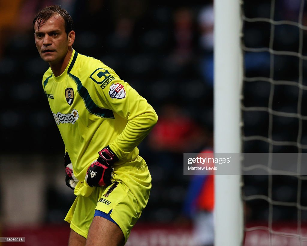 <a gi-track='captionPersonalityLinkClicked' href=/galleries/search?phrase=Roy+Carroll&family=editorial&specificpeople=206286 ng-click='$event.stopPropagation()'>Roy Carroll</a> of Notts County in action during the Pre Season Friendly match between Notts County and CA Osasuna at Meadow Lane on August 1, 2014 in Nottingham, England.