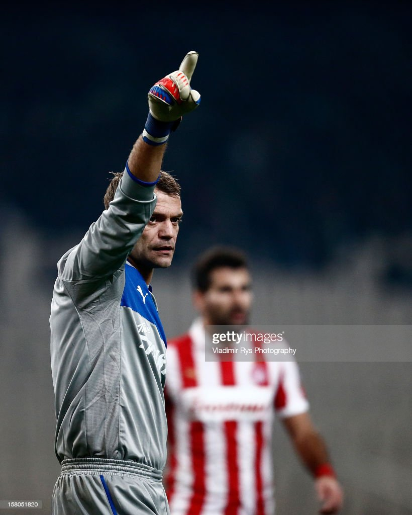 <a gi-track='captionPersonalityLinkClicked' href=/galleries/search?phrase=Roy+Carroll&family=editorial&specificpeople=206286 ng-click='$event.stopPropagation()'>Roy Carroll</a> of Olympiacos reacts during the Superleague match between Panathinaikos FC and Olympiacos Piraeus at OAKA Stadium on December 9, 2012 in Athens, Greece.