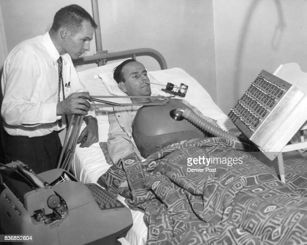 Roy Cary of Phillipsburg Kan an almost completely paralyzed polio patient at Craig Colony Rehabilitation Center 6101 W Colfax Ave is shown how to...