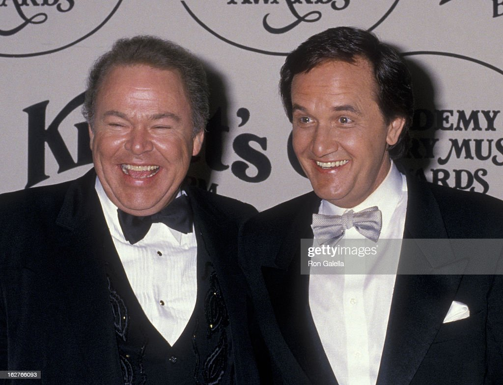 Roy Clark and Roger Miller attend 23rd Annual Academy of Country Music Awards on March 21 1988 at Knott's Berry Farm in Buena Park California