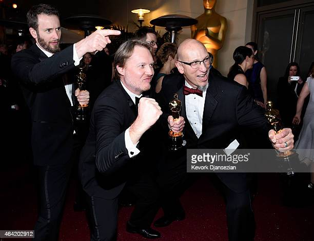 Roy Conli Don Hall and Chris Williams winners of the Best Animated Feature Award for 'Big Hero 6 attends the 87th Annual Academy Awards Governors...