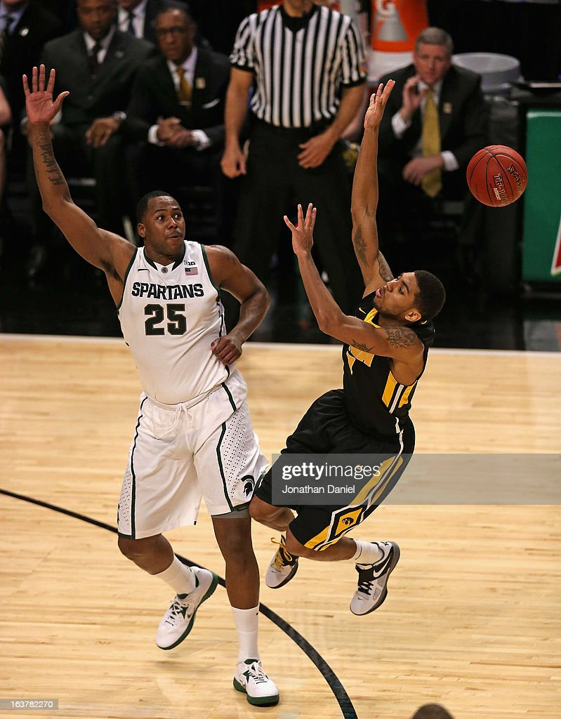 Roy Devyn Marble #4 of the Iowa Hawkeyes looses the ball after colliding with Derrick Nix #25 of the Michigan State Spartans during a quarterfinal game of the Big Ten Basketball Tournament at the United Center on March 15, 2013 in Chicago, Illinois. Michigan State defeats Iowa 59-56.