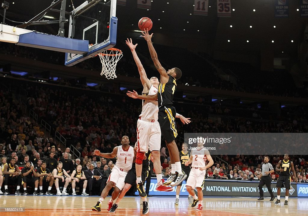 Roy Devyn Marble #4 of the Iowa Hawkeyes puts up a shot past <a gi-track='captionPersonalityLinkClicked' href=/galleries/search?phrase=Alex+Len&family=editorial&specificpeople=8529173 ng-click='$event.stopPropagation()'>Alex Len</a> #25 of the Maryland Terapins in the second half during the 2013 NIT Championship - Semifinals at the Madison Square Garden on April 2, 2013 in New York City.