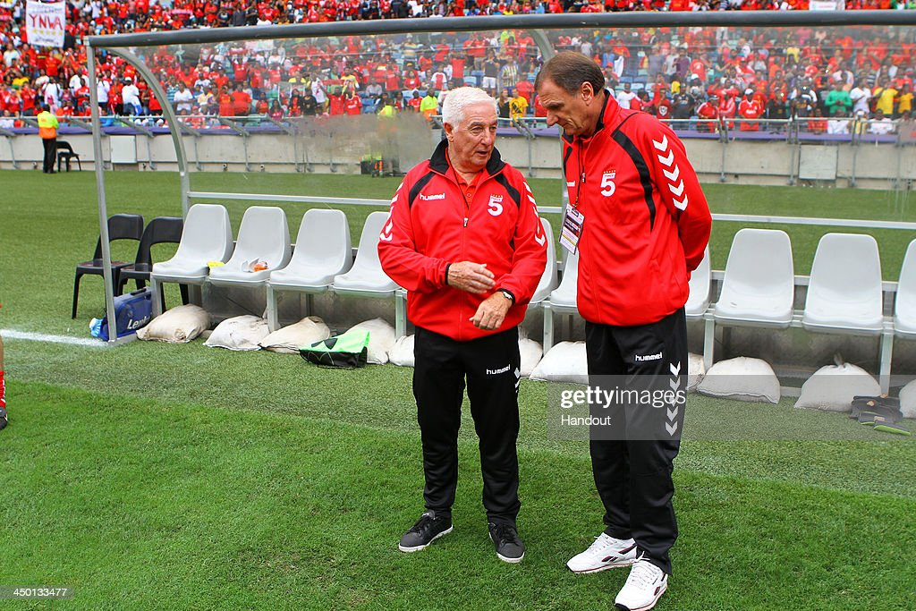 Roy Evans and Phil Thompson (R) have a chat during the Legends match between Liverpool FC Legends and Kaizer Chiefs Legends at Moses Mabhida Stadium on November 16, 2013 in Durban, South Africa.