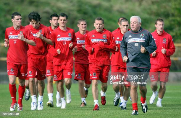 Roy Evans leads the warm up during a training session at Jenner Park Barry