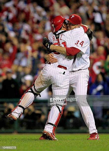Roy Halladay and Carlos Ruiz of the Philadelphia Phillies celebrate Halladay's nohitter and the win in Game 1 of the NLDS against the Cincinnati Reds...