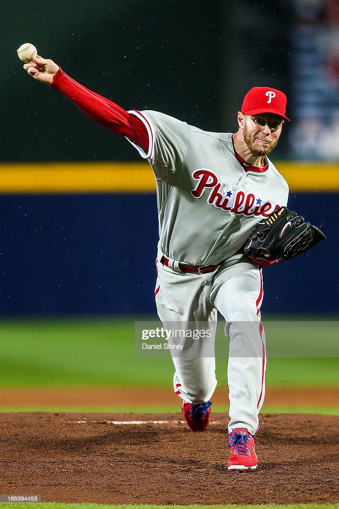 <a gi-track='captionPersonalityLinkClicked' href=/galleries/search?phrase=Roy+Halladay&family=editorial&specificpeople=208782 ng-click='$event.stopPropagation()'>Roy Halladay</a> #34 of the Philadelphia Phillies pitches in the first inning of the game against the Atlanta Braves at Turner Field on April 3, 2013 in Atlanta, Georgia.