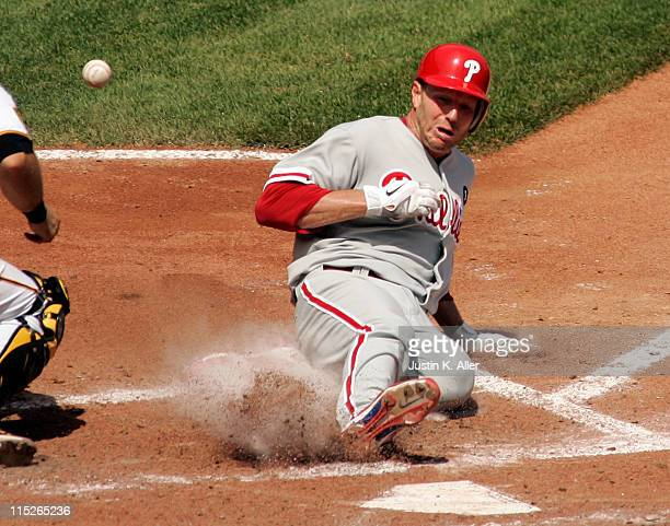 Roy Halladay of the Philadelphia Phillies scores on a play at the plate against the Pittsburgh Pirates during the game on June 5 2011 at PNC Park in...