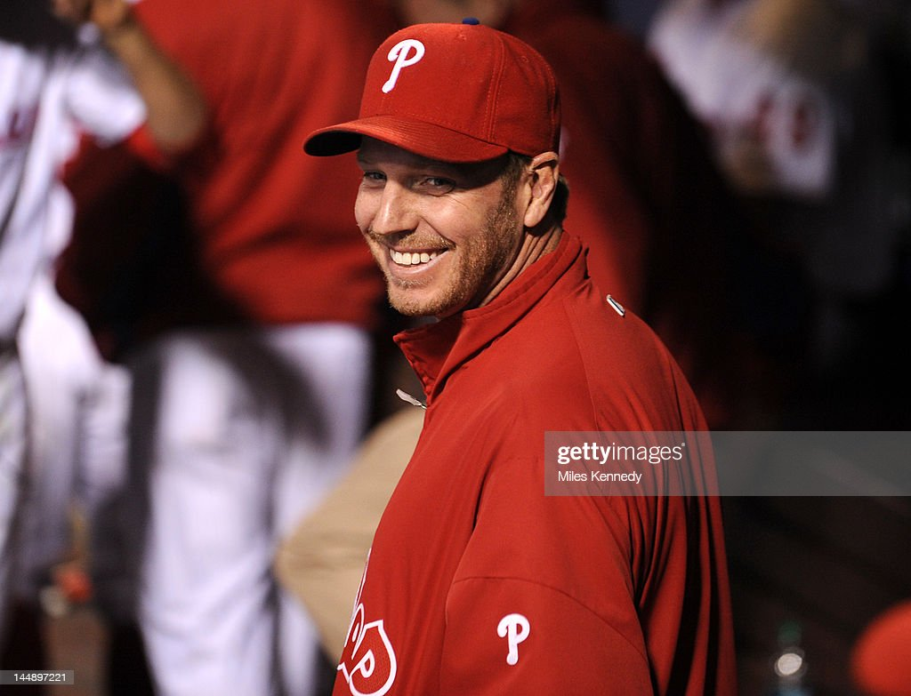 <a gi-track='captionPersonalityLinkClicked' href=/galleries/search?phrase=Roy+Halladay&family=editorial&specificpeople=208782 ng-click='$event.stopPropagation()'>Roy Halladay</a> #34 of the Philadelphia Phillies talks to teammates in the dugout during the sixth inning against the Boston Red Sox on May 18, 2012 at Citizens Bank Park in Philadelphia, Pennsylvania. The Phillies won 6-4.
