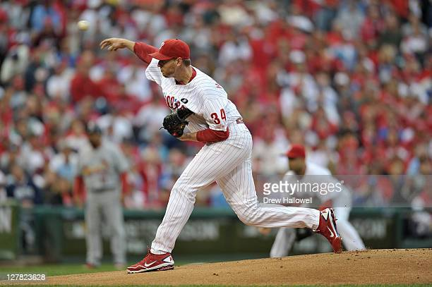 Roy Halladay of the Philadelphia Phillies throws a pitch in the first inning againt the St Louis Cardinals during Game One of the National League...