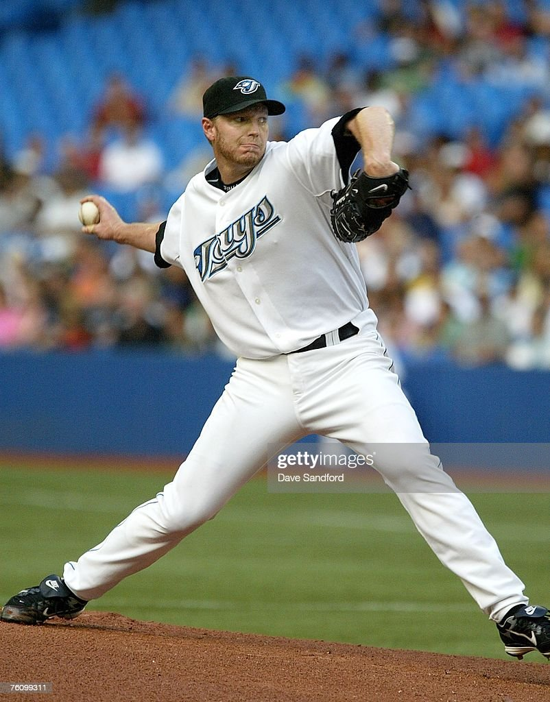 Roy Halladay #32 of the Toronto Blue Jays throws a pitch against the Los Angeles Angels of Anaheim at on August 14, 2007 the Rogers Centre in Toronto, Ontario, Canada.
