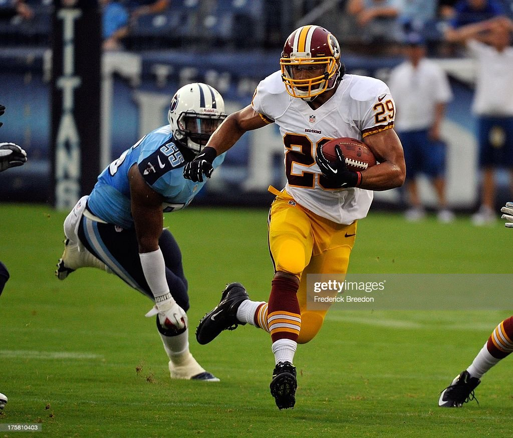 <a gi-track='captionPersonalityLinkClicked' href=/galleries/search?phrase=Roy+Helu&family=editorial&specificpeople=4547489 ng-click='$event.stopPropagation()'>Roy Helu</a> #29 of the Washington Redskins runs past <a gi-track='captionPersonalityLinkClicked' href=/galleries/search?phrase=Zach+Brown+-+American+Football+Player&family=editorial&specificpeople=6705522 ng-click='$event.stopPropagation()'>Zach Brown</a> #55 of the Tennessee Titans during a pre-season game at LP Field on August 8, 2013 in Nashville, Tennessee.