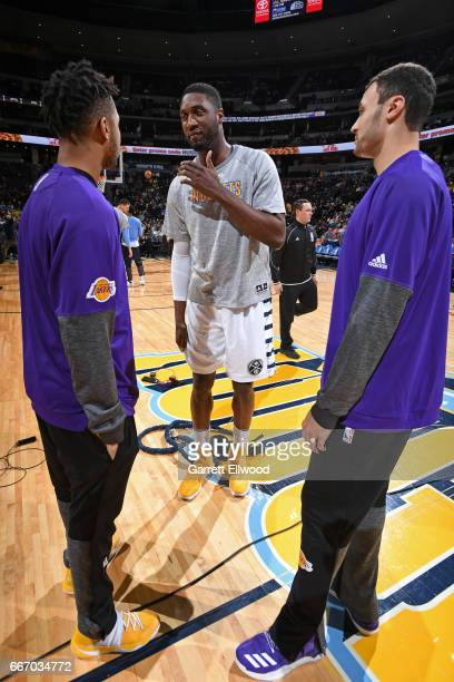 Roy Hibbert of the Denver Nuggets talks with D'Angelo Russell and Larry Nance Jr #7 of the Los Angeles Lakers before the game on March 13 2017 at the...