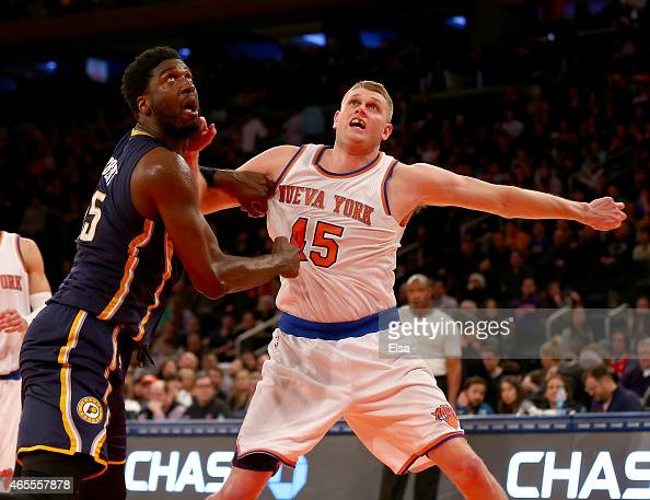Roy Hibbert of the Indiana Pacers and Cole Aldrich of the New York Knicks fight for position at Madison Square Garden on March 7 2015 in New York...