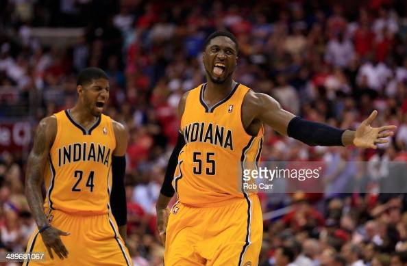 Roy Hibbert of the Indiana Pacers and teammate Paul George celebrate after Hibbert scored a basket late in the fourth quarter of the Pacers 9592 win...