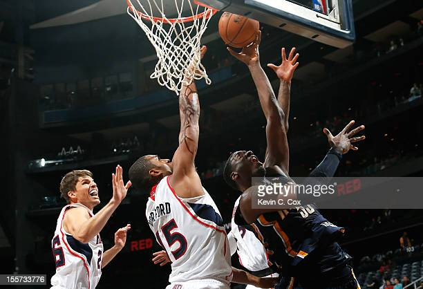Roy Hibbert of the Indiana Pacers attackes the basket against Al Horford and Kyle Korver of the Atlanta Hawks at Philips Arena on November 7 2012 in...