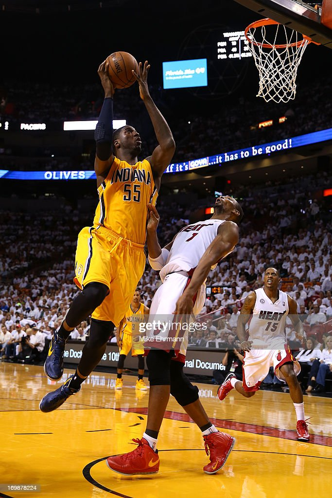 <a gi-track='captionPersonalityLinkClicked' href=/galleries/search?phrase=Roy+Hibbert&family=editorial&specificpeople=725128 ng-click='$event.stopPropagation()'>Roy Hibbert</a> #55 of the Indiana Pacers attempts a shot in the third quarter against <a gi-track='captionPersonalityLinkClicked' href=/galleries/search?phrase=Chris+Bosh&family=editorial&specificpeople=201574 ng-click='$event.stopPropagation()'>Chris Bosh</a> #1 of the Miami Heat during Game Seven of the Eastern Conference Finals of the 2013 NBA Playoffs at AmericanAirlines Arena on June 3, 2013 in Miami, Florida.