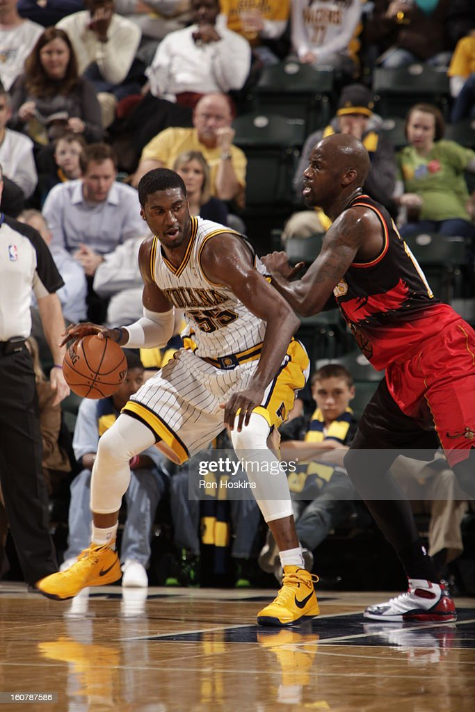 <a gi-track='captionPersonalityLinkClicked' href=/galleries/search?phrase=Roy+Hibbert&family=editorial&specificpeople=725128 ng-click='$event.stopPropagation()'>Roy Hibbert</a> #55 of the Indiana Pacers backs up to the basket while dribbling the ball against the Atlanta Hawks on February 5, 2013 at Bankers Life Fieldhouse in Indianapolis, Indiana.