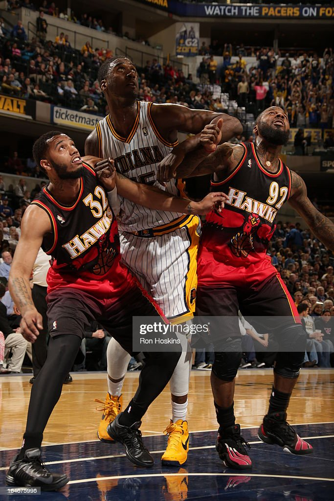 Roy Hibbert #55 of the Indiana Pacers battles for positioning against Mike Scott #32 and DeShawn Stevenson #92 of the Atlanta Hawks on March 25, 2013 at Bankers Life Fieldhouse in Indianapolis, Indiana.