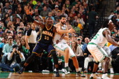 Roy Hibbert of the Indiana Pacers battles for positioning against Vitor Faverani of the Boston Celtics on November 22 2013 at the TD Garden in Boston...
