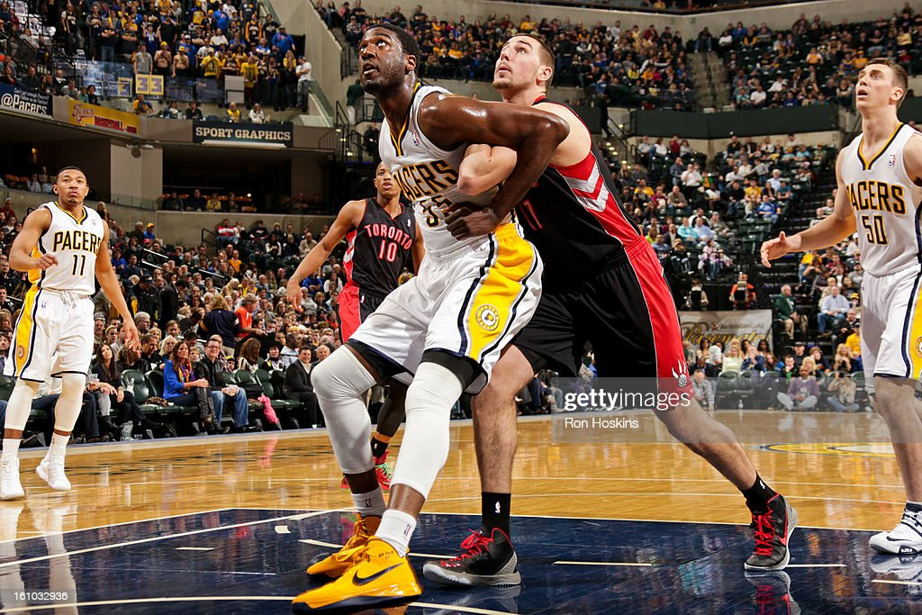 Roy Hibbert #55 of the Indiana Pacers battles for rebound position against Jonas Valanciunas #17 of the Toronto Raptors on February 8, 2013 at Bankers Life Fieldhouse in Indianapolis, Indiana.