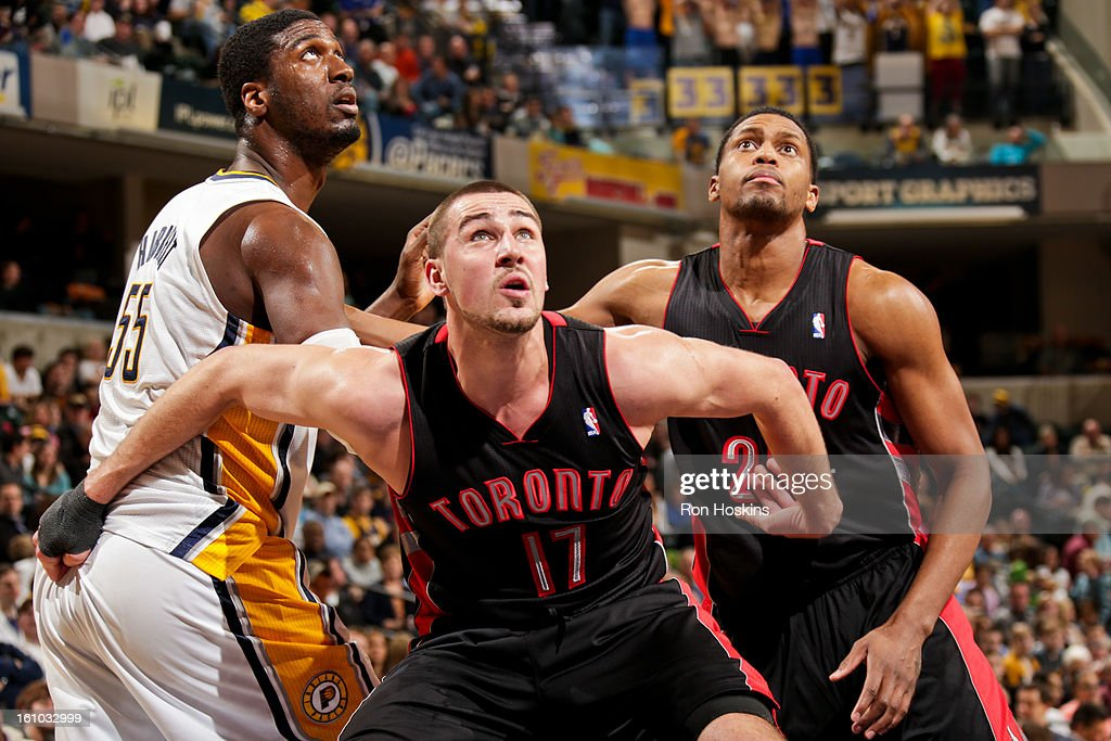 Roy Hibbert #55 of the Indiana Pacers battles for rebound position against Jonas Valanciunas #17 and Rudy Gay #22 of the Toronto Raptors on February 8, 2013 at Bankers Life Fieldhouse in Indianapolis, Indiana.