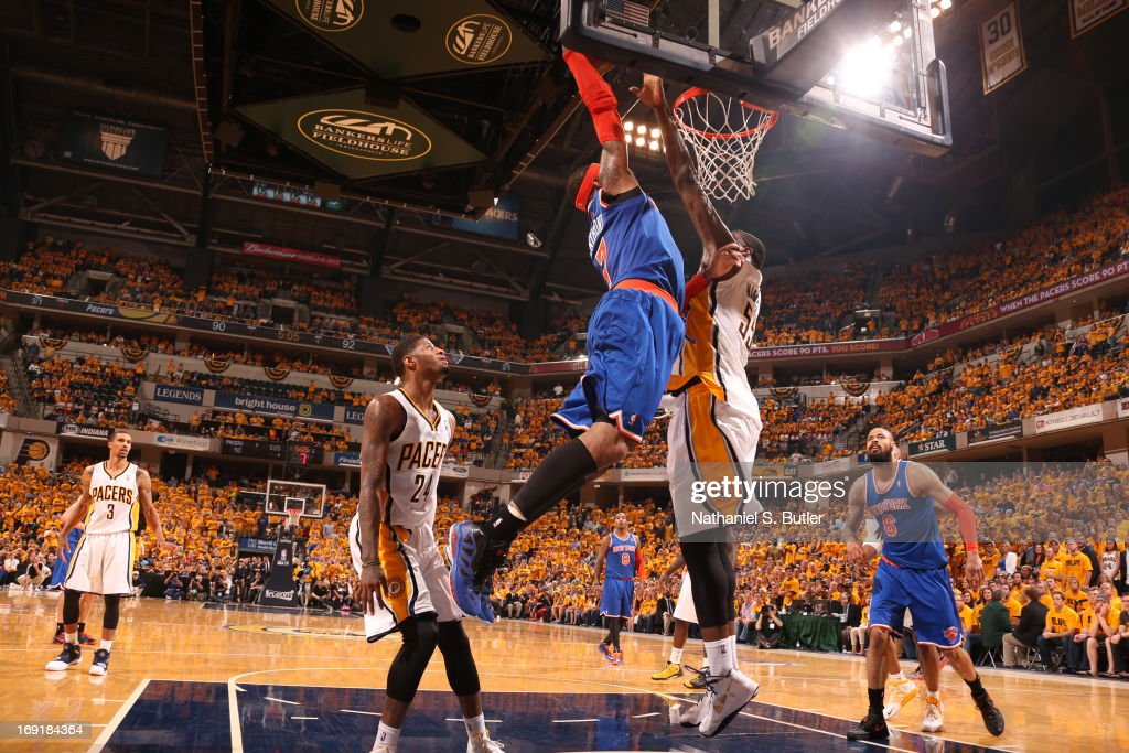 <a gi-track='captionPersonalityLinkClicked' href=/galleries/search?phrase=Roy+Hibbert&family=editorial&specificpeople=725128 ng-click='$event.stopPropagation()'>Roy Hibbert</a> #55 of the Indiana Pacers blocks a dunk attempt by <a gi-track='captionPersonalityLinkClicked' href=/galleries/search?phrase=Carmelo+Anthony&family=editorial&specificpeople=201494 ng-click='$event.stopPropagation()'>Carmelo Anthony</a> #7 of the New York Knicks in Game Six of the Eastern Conference Semifinals during the 2013 NBA Playoffs on May 18, 2013 at Bankers Life Fieldhouse in Indianapolis, Indiana.