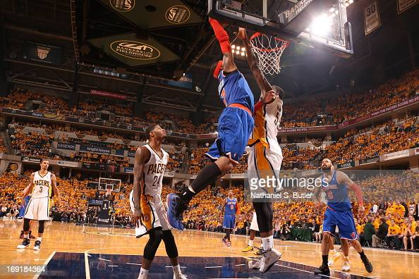 Roy Hibbert of the Indiana Pacers blocks a dunk attempt by Carmelo Anthony of the New York Knicks in Game Six of the Eastern Conference Semifinals...