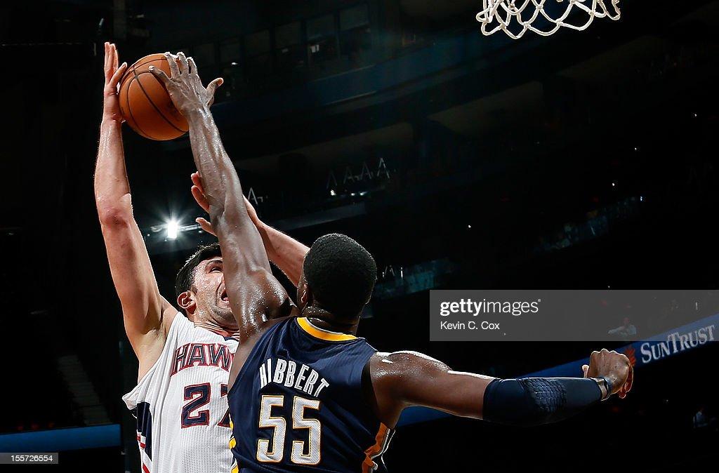 Roy Hibbert #55 of the Indiana Pacers blocks a shot by Zaza Pachulia #27 of the Atlanta Hawks at Philips Arena on November 7, 2012 in Atlanta, Georgia.