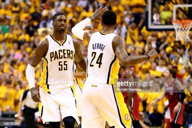 Roy Hibbert of the Indiana Pacers celebrates with teammate Paul George after scoring against the Miami Heat in Game Six of the Eastern Conference...