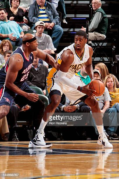 Roy Hibbert of the Indiana Pacers controls the ball against Erick Dampier of the Atlanta Hawks on March 6 2012 at Bankers Life Fieldhouse in...
