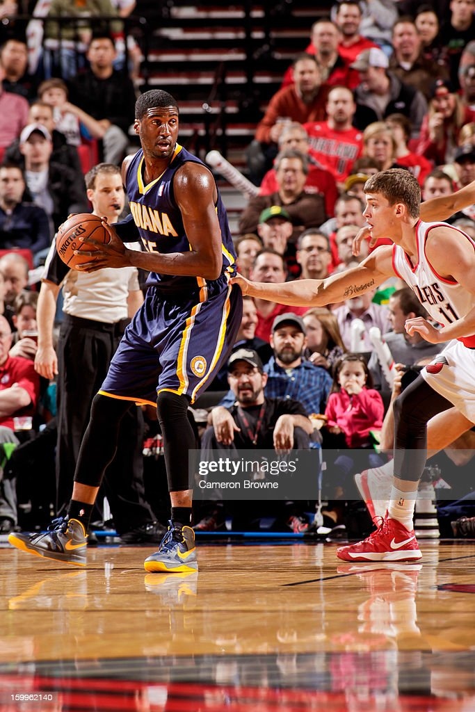 Roy Hibbert #55 of the Indiana Pacers controls the ball against Meyers Leonard #11 of the Portland Trail Blazers on January 23, 2013 at the Rose Garden Arena in Portland, Oregon.