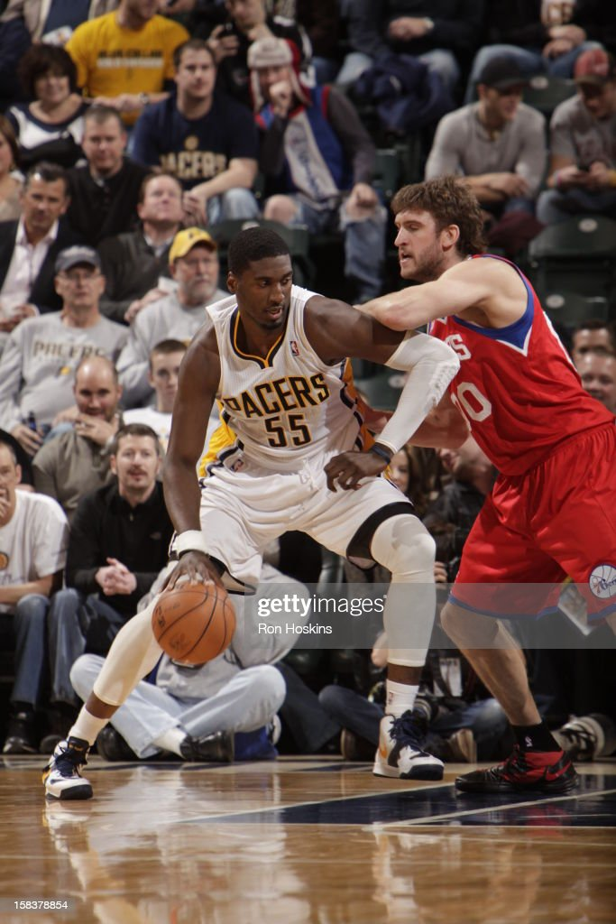 Roy Hibbert #55 of the Indiana Pacers controls the ball against Spencer Hawes #00 of the Philadelphia 76ers on December 14, 2012 at Bankers Life Fieldhouse in Indianapolis, Indiana.