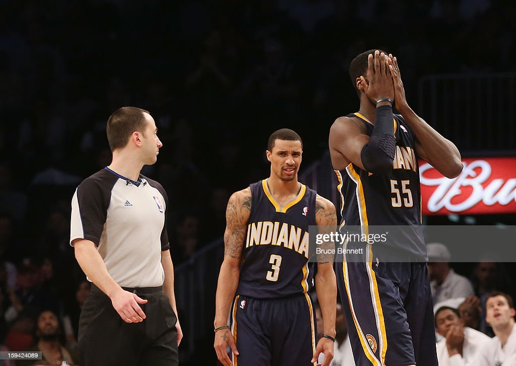 Roy Hibbert #55 of the Indiana Pacers covers his face after being called for a foul in the fourth quarter against the Brooklyn Nets at the Barclays Center on January 13, 2013 in New York City.