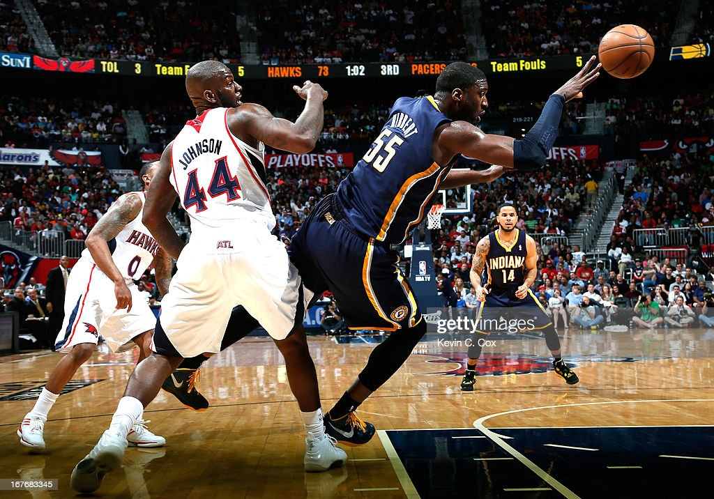 Roy Hibbert #55 of the Indiana Pacers draws a foul from Ivan Johnson #44 of the Atlanta Hawks during Game Three of the Eastern Conference Quarterfinals of the 2013 NBA Playoffs at Philips Arena on April 27, 2013 in Atlanta, Georgia.
