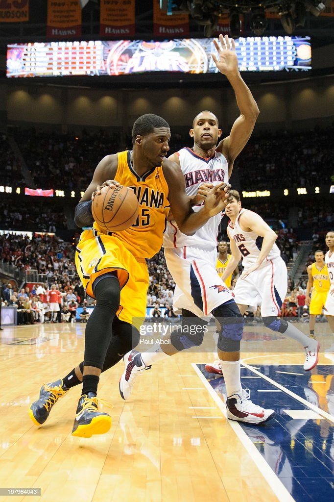 Roy Hibbert #55 of the Indiana Pacers drives against Al Horford #15 of the Atlanta Hawks during the second half at Philips Arena on May 3, 2013 in Atlanta, Georgia. The Pacers defeated the Hawks 81-73.
