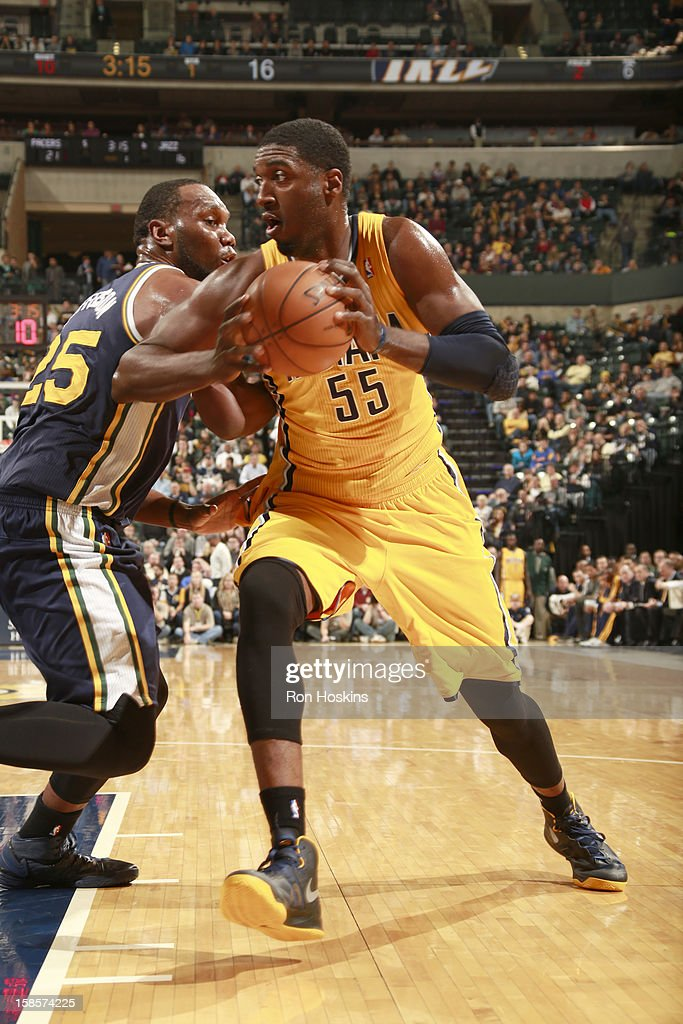Roy Hibbert #55 of the Indiana Pacers drives against Al Jefferson #25 of the Utah Jazz during the game between the Indiana Pacers and the Utah Jazz on December 19, 2012 at Bankers Life Fieldhouse in Indianapolis, Indiana.