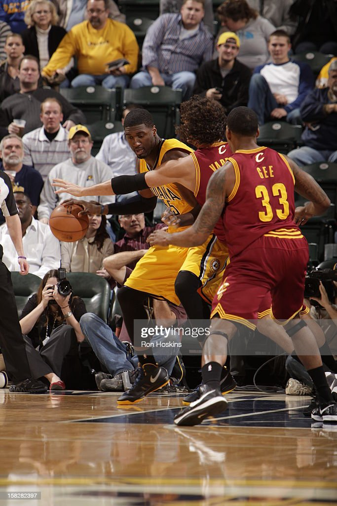 Roy Hibbert #55 of the Indiana Pacers drives against Anderson Varejao #17 and Alonzo Gee #33 of the Cleveland Cavaliers during the game between the Indiana Pacers and the Cleveland Cavaliers on December 12, 2012 at Bankers Life Fieldhouse in Indianapolis, Indiana.