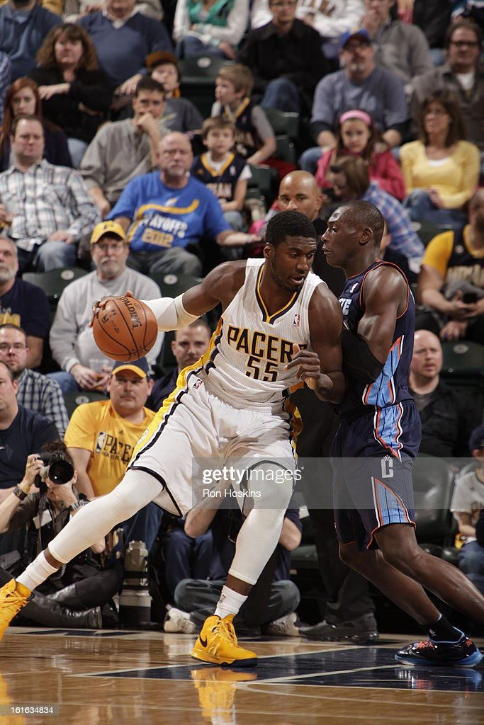 Roy Hibbert #55 of the Indiana Pacers drives against Bismack Biyombo #0 of the Charlotte Bobcats on February 13, 2013 at Bankers Life Fieldhouse in Indianapolis, Indiana.
