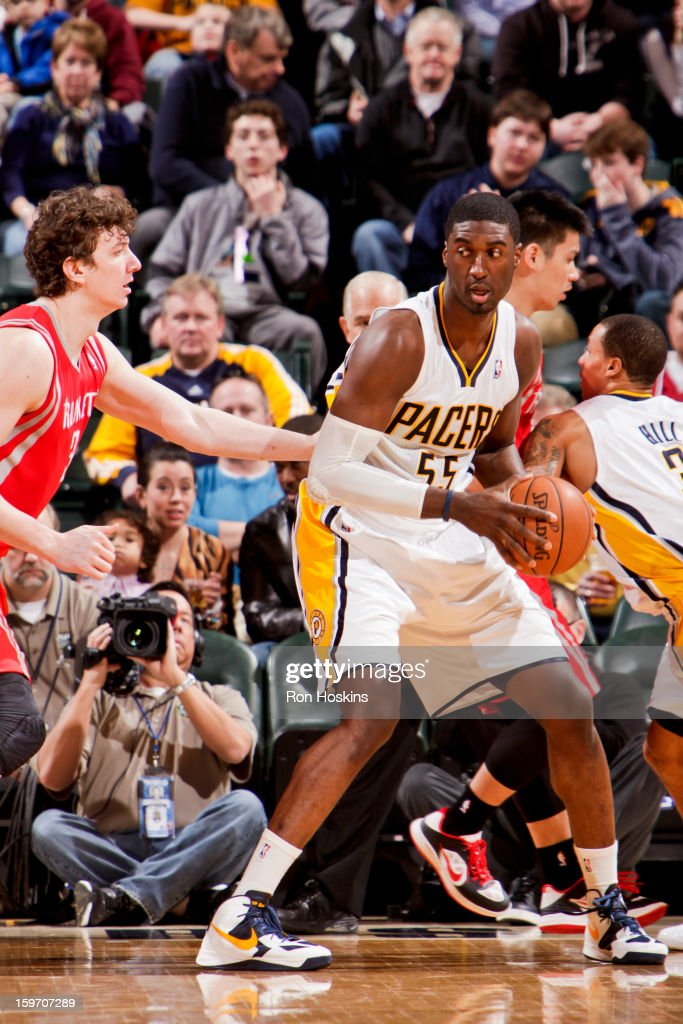 Roy Hibbert #55 of the Indiana Pacers drives against Omer Asik #3 of the Houston Rockets on January 18, 2013 at Bankers Life Fieldhouse in Indianapolis, Indiana.
