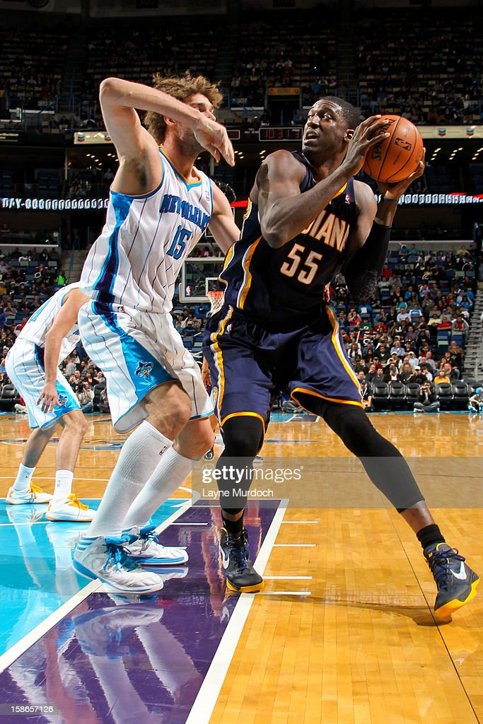 Roy Hibbert #55 of the Indiana Pacers drives against Robin Lopez #15 of the New Orleans Hornets on December 22, 2012 at the New Orleans Arena in New Orleans, Louisiana.