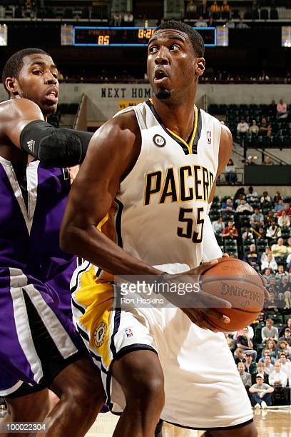 Roy Hibbert of the Indiana Pacers drives the ball against the Sacramento Kings during the game on March 30 2010 at Conseco Fieldhouse in Indianapolis...
