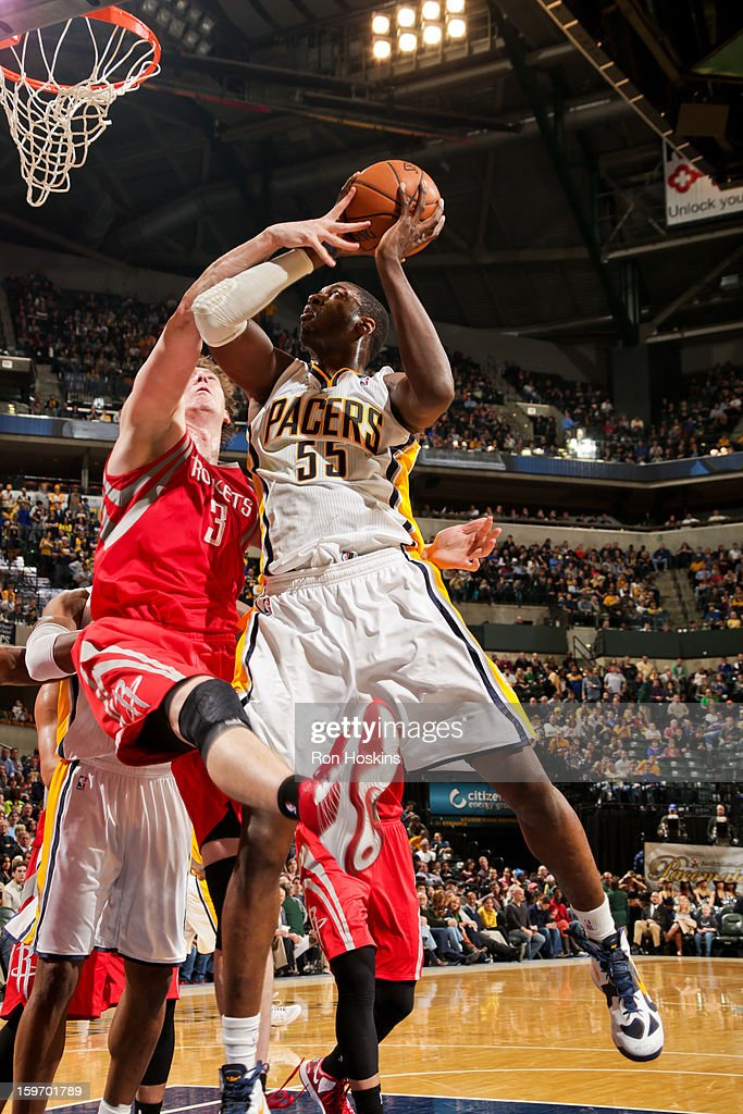 Roy Hibbert #55 of the Indiana Pacers drives to the basket against Omer Asik #3 of the Houston Rockets on January 18, 2013 at Bankers Life Fieldhouse in Indianapolis, Indiana.